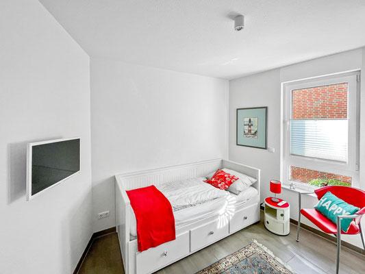 Das Schlafzimmer mit TV