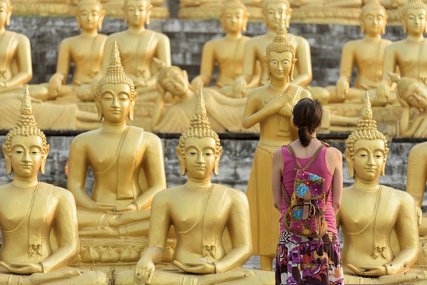 Having a closer look at the many Buddhas in Pakse, Laos