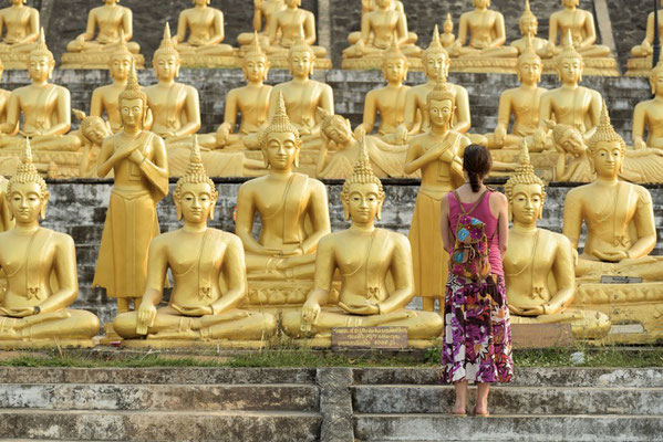 Wow, what a feeling standing in front of so many Buddhas in Pakse, Laos