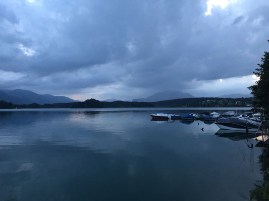 Lake Faak after sunset, with dark clouds