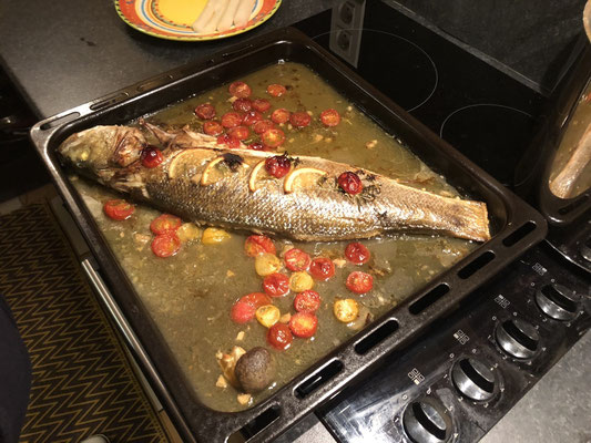"""Mihaela is a great chef and is cooking us a """"loup de mer""""- in Bourdic, Provence (South of France)"""
