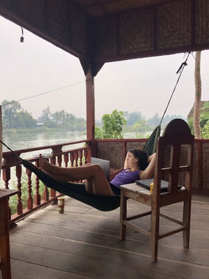 Irene finally chilling and writing in a hammock in Don Khon, Laos
