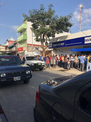 Mexicans waiting at the bank