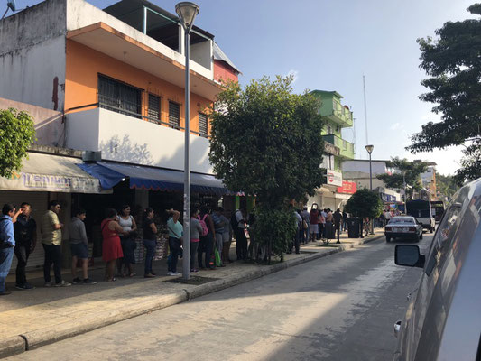 Mexicans waiting at the bank - such a long queue