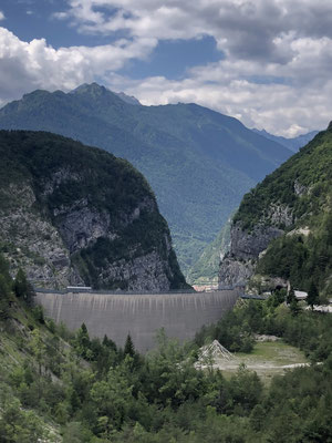 The remaining Vajont dam with all the moved land covered by trees