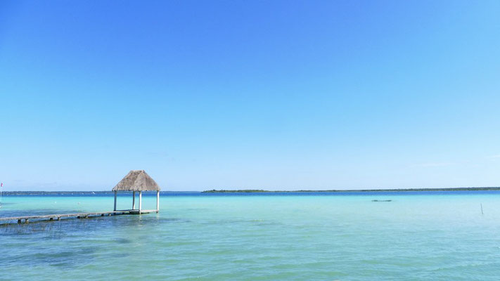 "A little hut on a lonely pier at lake Bacalar, as well called ""The lake of the seven colours"""