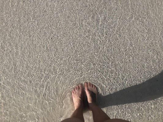 Crystal clear water in Holbox and Irene's feet
