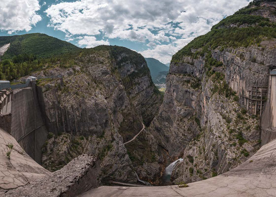 The tall Vajont dam and the view to Longarone