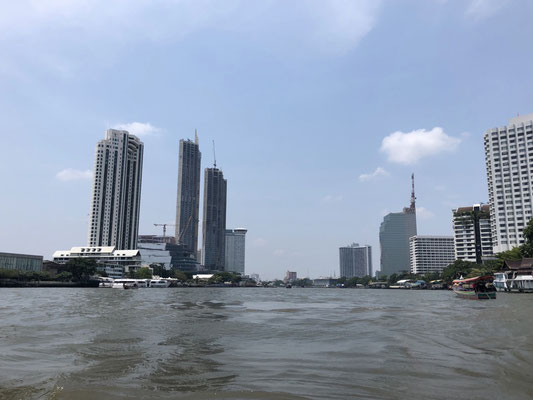 Admiring Bangkok's skyline from a long tail boat