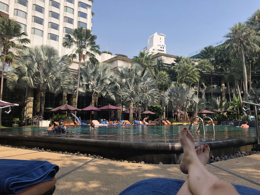Spending some chill time at the pool of our hotel in Bangkok, Thailand