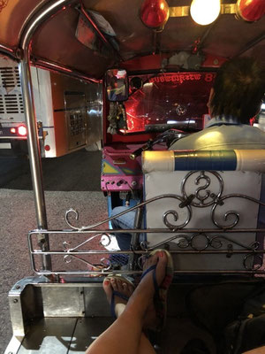 Enjoying a lazy ride in the back of a Tuk Tuk in Bangkok, Thailand