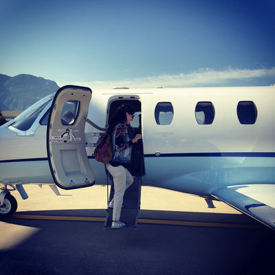 Happy girl: Boarding a private jet at Bozen, Bolzano airport