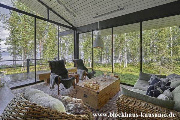 Modernes Wohnen im Blockhaus  -  Wohnblockhaus mit Wintergarten - Blockhausbau - Holzbau