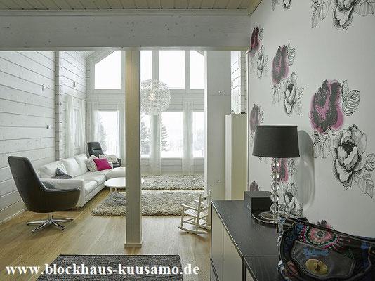 Wohnzimmer mit  Panoramafenster im Blockhaus -Holzhaus, Holzbau, Bauen, Hausbau, Wohnhaus, Planung, Architektenhaus, Architekt, Wohnen