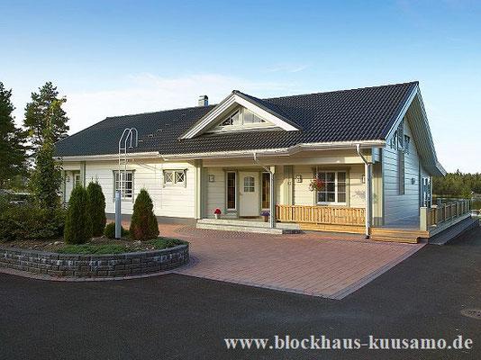 Holzhaus in massiver Blockbauweise - Einfamilienhaus in Weiß