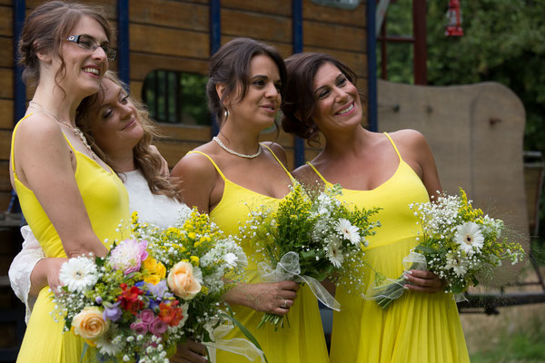 Festival Wedding Bridesmaids and Flowers