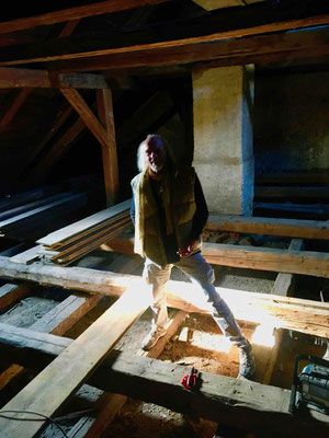 Me standing on the timbers of the opened floor in the attic