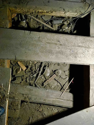 The filling underneath the timbers in the attic