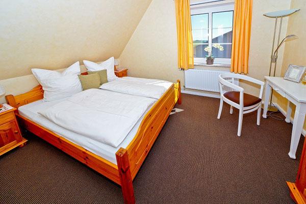 Schlafzimmer in der Wohnung Norderoog