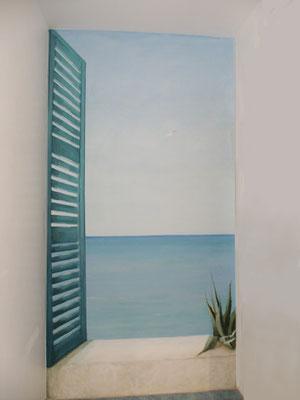 Durch diese Wandmalerei in einem Badezimmer kommt Ibiza-Feeling auf
