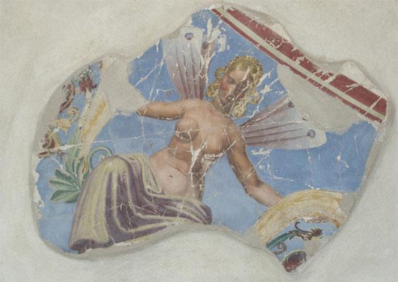 Farbabplatzungen werden mit den original historischen Pigmenten wieder angeglichen