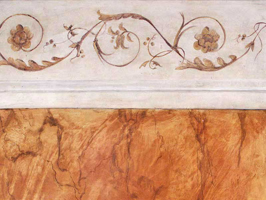 Ornamente an die Wand malen