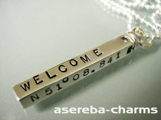Drehbarer Silberbarren beschriftet z.B. mit Ihren Koordinaten oder Namen etc.