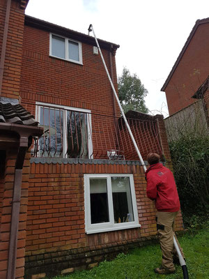 Vac system in use to clear the guttering on this 3 storey house in Exeter