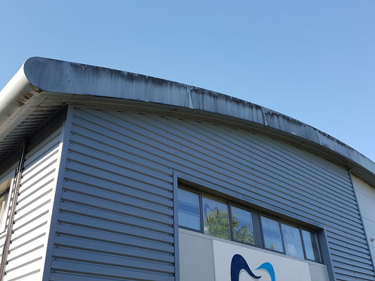 Black algae cladding cleaning commercial property in Exeter