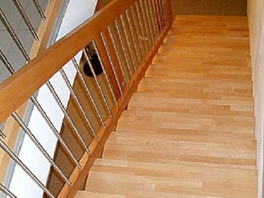 Treppengeländer in Buche mit Edelstahlsprossen