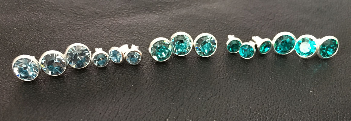 v.l.n.r. Aquamarin, Aquamarin klein, light turquoise, blue zircon klein, blue zircon
