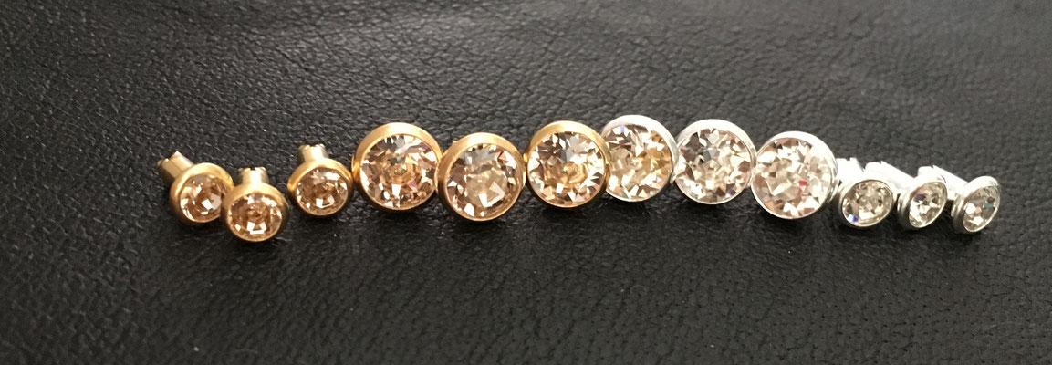 Crystal (v.l.n.r. klein gold, groß gold, groß silber, klein silber)
