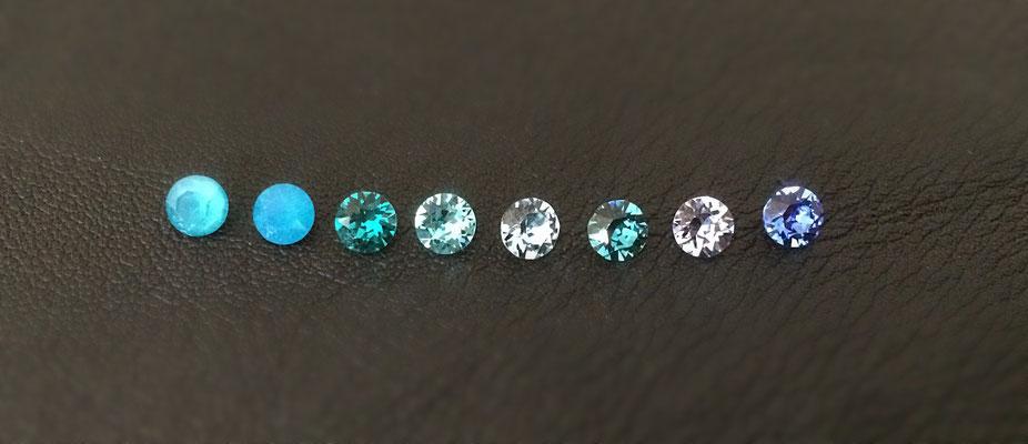v.l.n.r.: Azure Blue, Caribbean Blue Opal, Blue Zircon, lt. turquoise, Aquamarine, Indicolite, lt. Sapphire, Sapphire