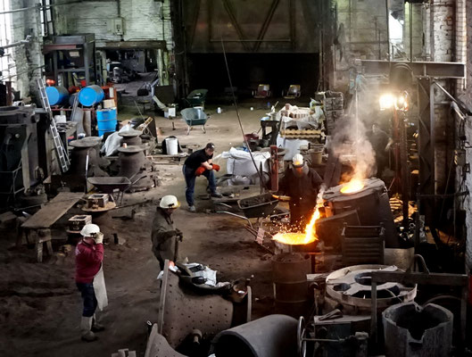 A mixture of copper  and tin is poured into the moulds at 1000 decrees Celsius.
