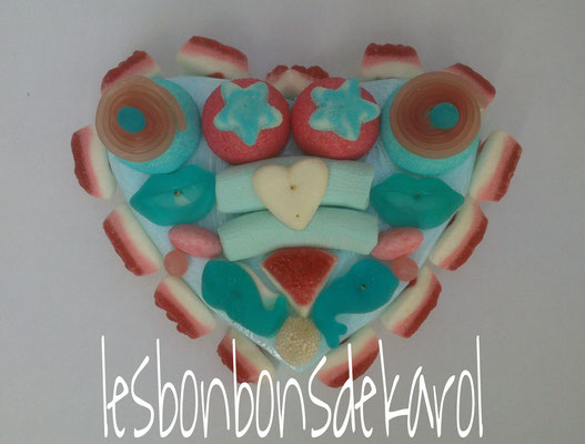 petit coeur bleurose 10 € (env. 260 gr et 32 bonbons - 22x18 cm)