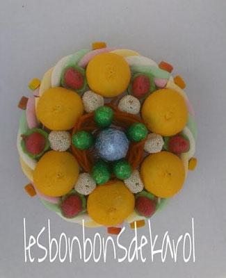 nid de pâques orange 15 € (env. 260 gr bonbons et chocolats - diam 20 ht 10 cm)