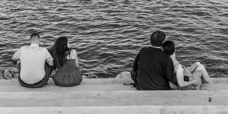 couples on the mississippi shore, new orleans, louisiana