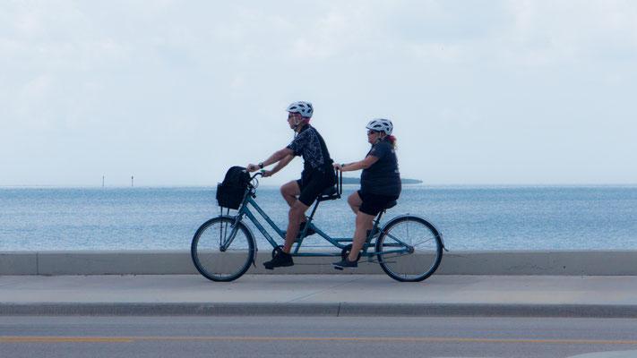 couple on tandem bike, key west, florida