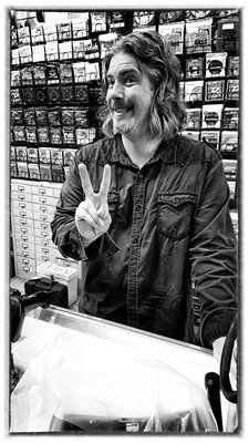 friendly guy in guitar store, haight, san francisco, usa