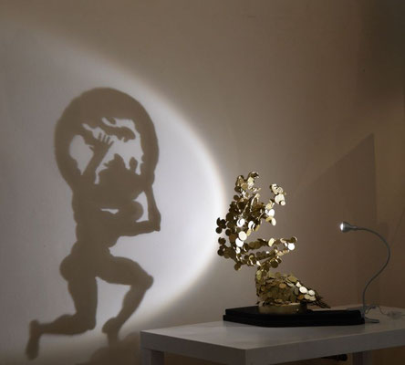Atlas of Balance. About the financial market. Shadow sculpture
