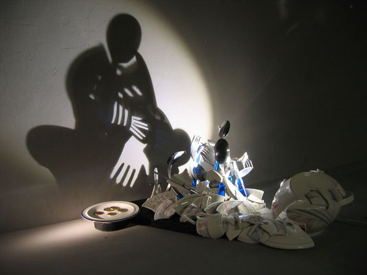 Shattered. About rich and poor. Shadow sculpture