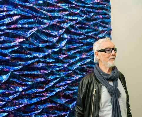 Composer Chris Hinze in front of the painting Eternity by Walter van Oel. Photo: Dick Renses