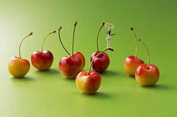 """Christopher Boffoli, """"Cherry Acrobat,""""  acrylic-dibond mounted photograph, 24 x 36 inches, (also available: 12 x 18, 32 x 48, 48 x 72)"""