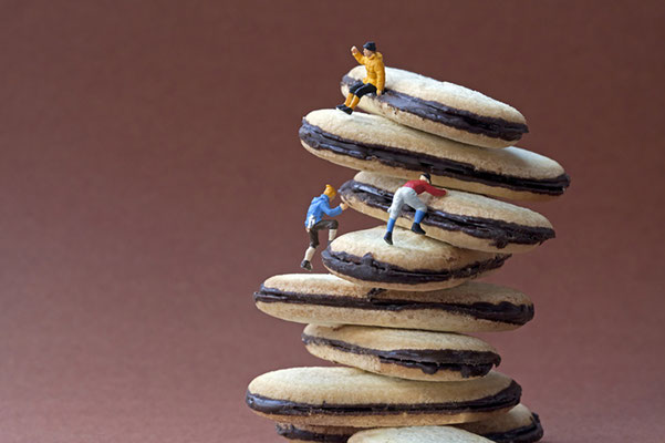 "Christopher Boffoli, ""Cookie Climbers,"" 2018, acrylic-dibond mounted photograph, 24 x 36 inches, (also available: 12 x 18, 32 x 48, 48 x 72)"