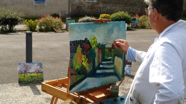 Serge achève le tableau sur la rue des Pyrénées