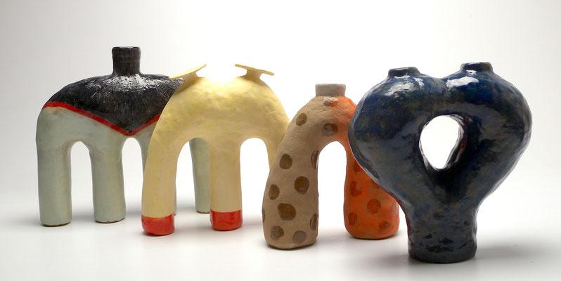Size: Around 10 inches tall, Underglaze, slip and glaze on ceramic