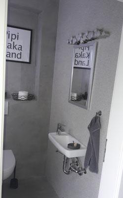 Brilliantputz PEARL hinter Waschbecken