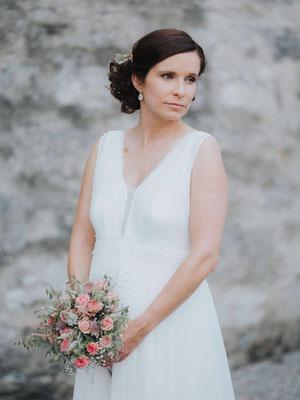 Brautfrisur-Locken-hochgesteckt-Coiffeur-Lockenroll-für-Braufrisuren