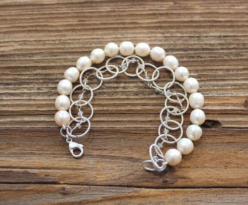 139) Armband Silber 925 mit Süsswasserperlen und weissem Zirkon, 560.-