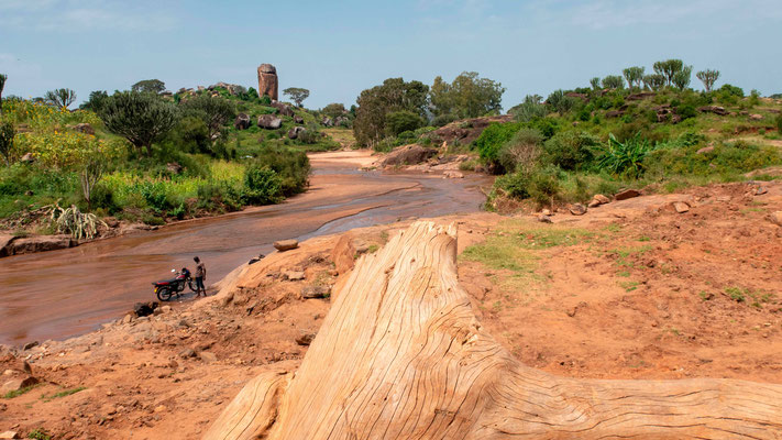 Landscape of north-eastern Uganda. Motorbikes are washed in the rivers...